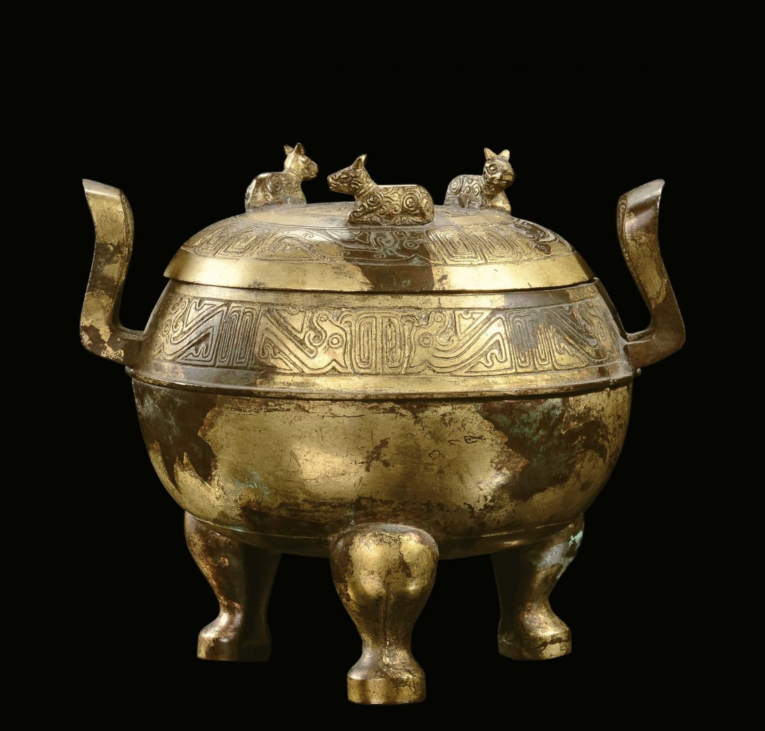 A bronze gilt censer and cover with stylized