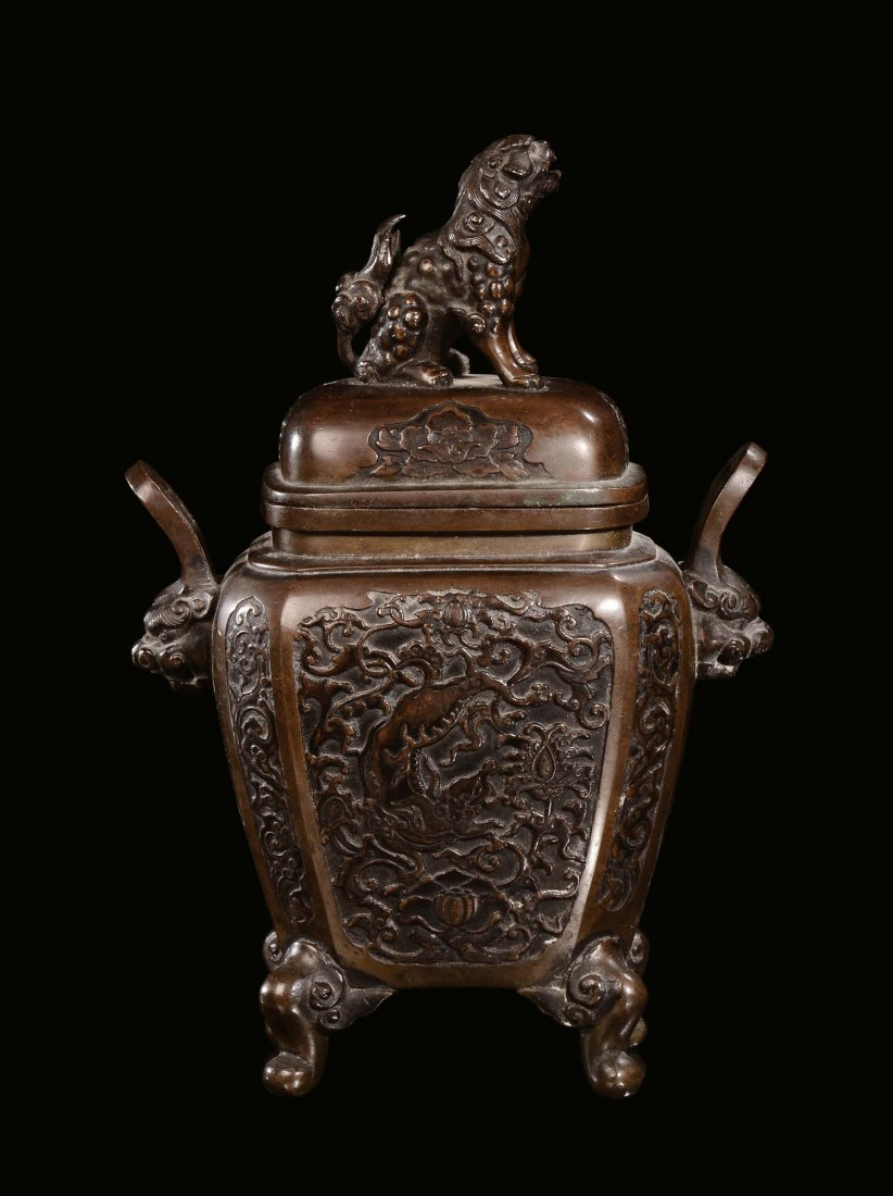 A bronze incense burner with stylized decoration, on