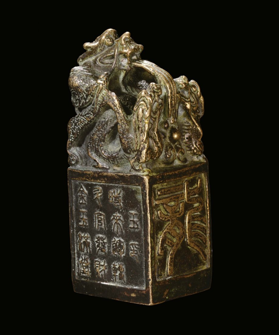 A bronze Chinese seal with square base with engraving