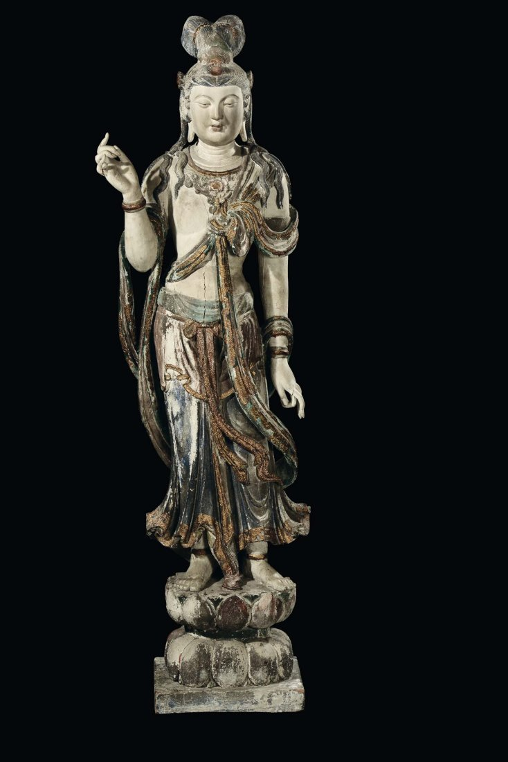 A large and important polychrome carved wood divinity,