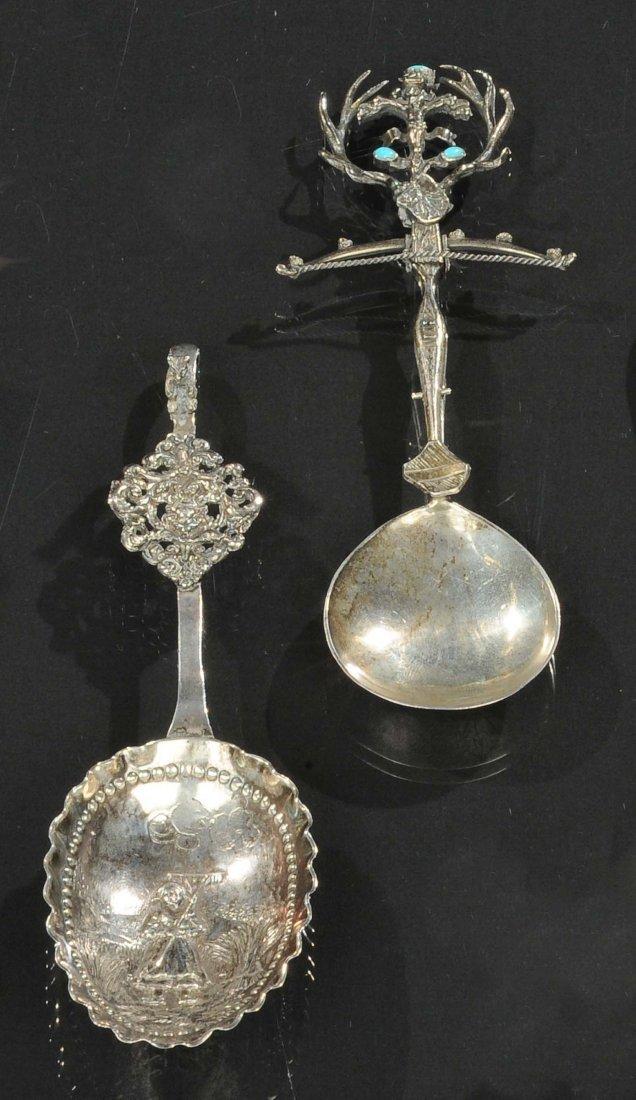 Lotto composto da due cucchiai da cerimonia in argento