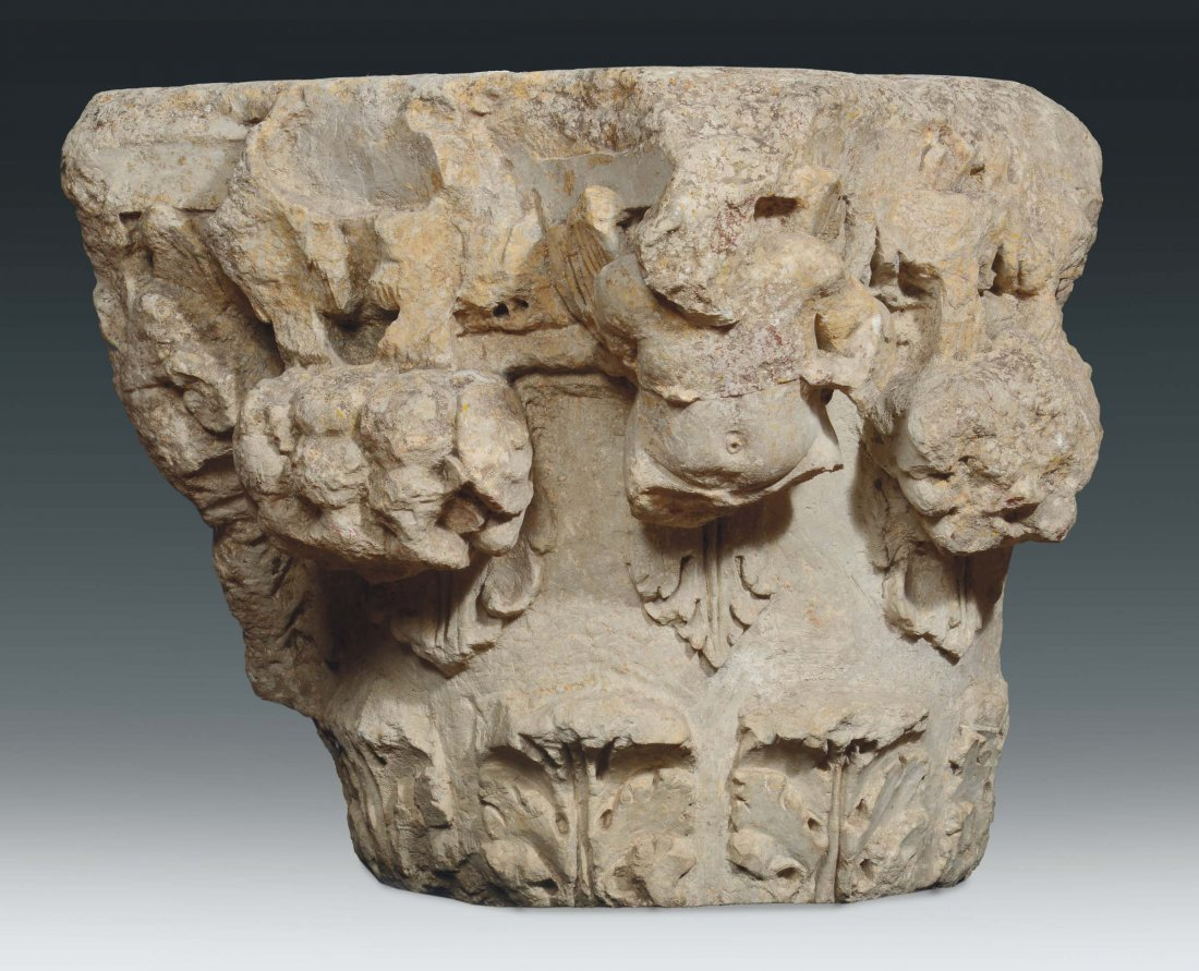 A stone capital carved on two sides with