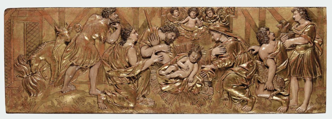 A carved and gilt wood high-relief representing the