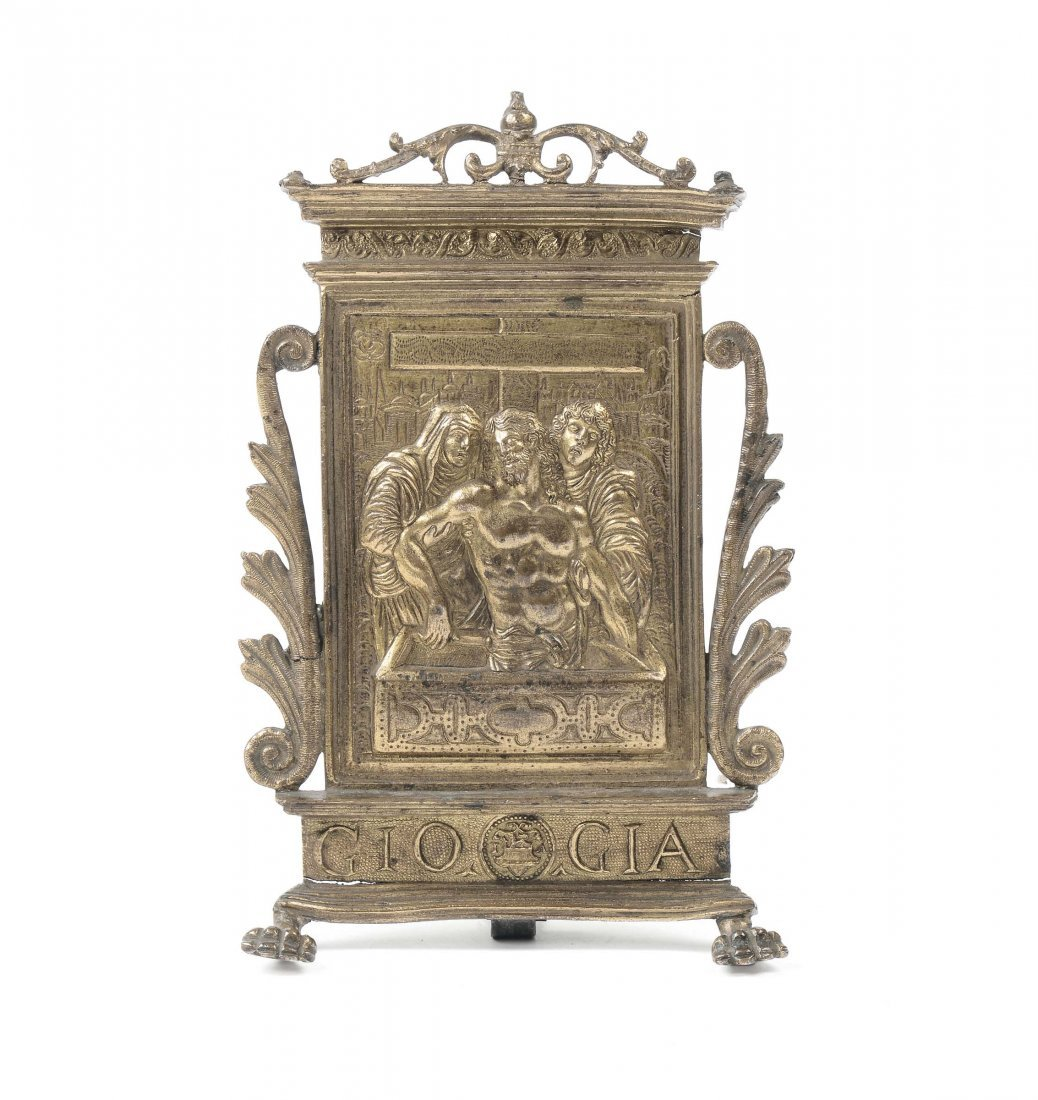 A molten, chiselled and gilt bronze pax representing