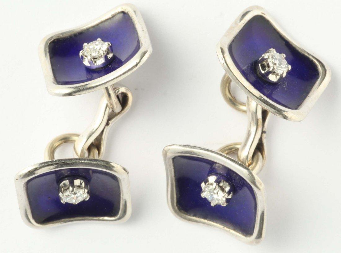 A enamel, diamond and platinum cufflinks