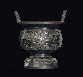A bronze two-handled censer in arcaic form with Taotie