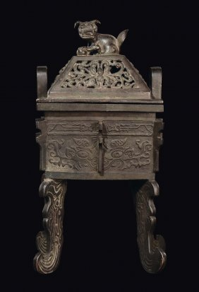 A carved bronze censer in arcaic form with Pho dog on