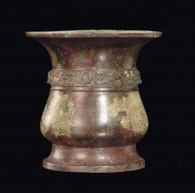 A rare bronze vase chiseled with archaic decoration