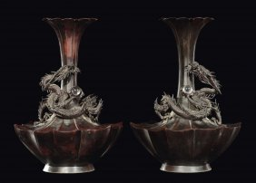 A pair of bronze bottle vases with relief dragons,