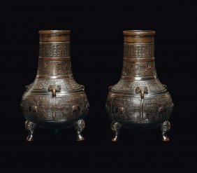 A pair of small bronze vases, archaic shape and