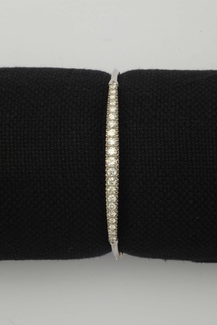 A diamond and gold bangle