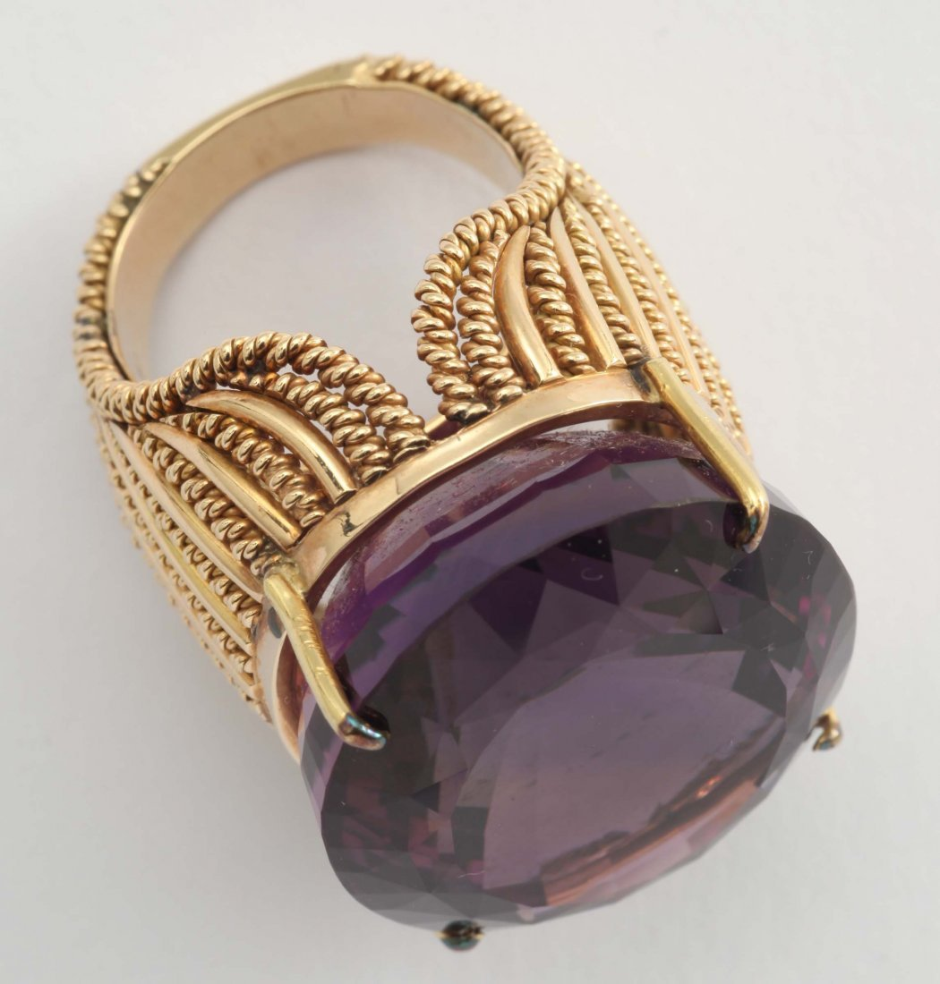 An amethyst and gold ring