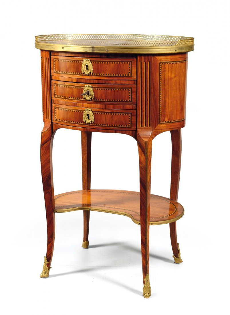A small oval table with three drawers, Transition