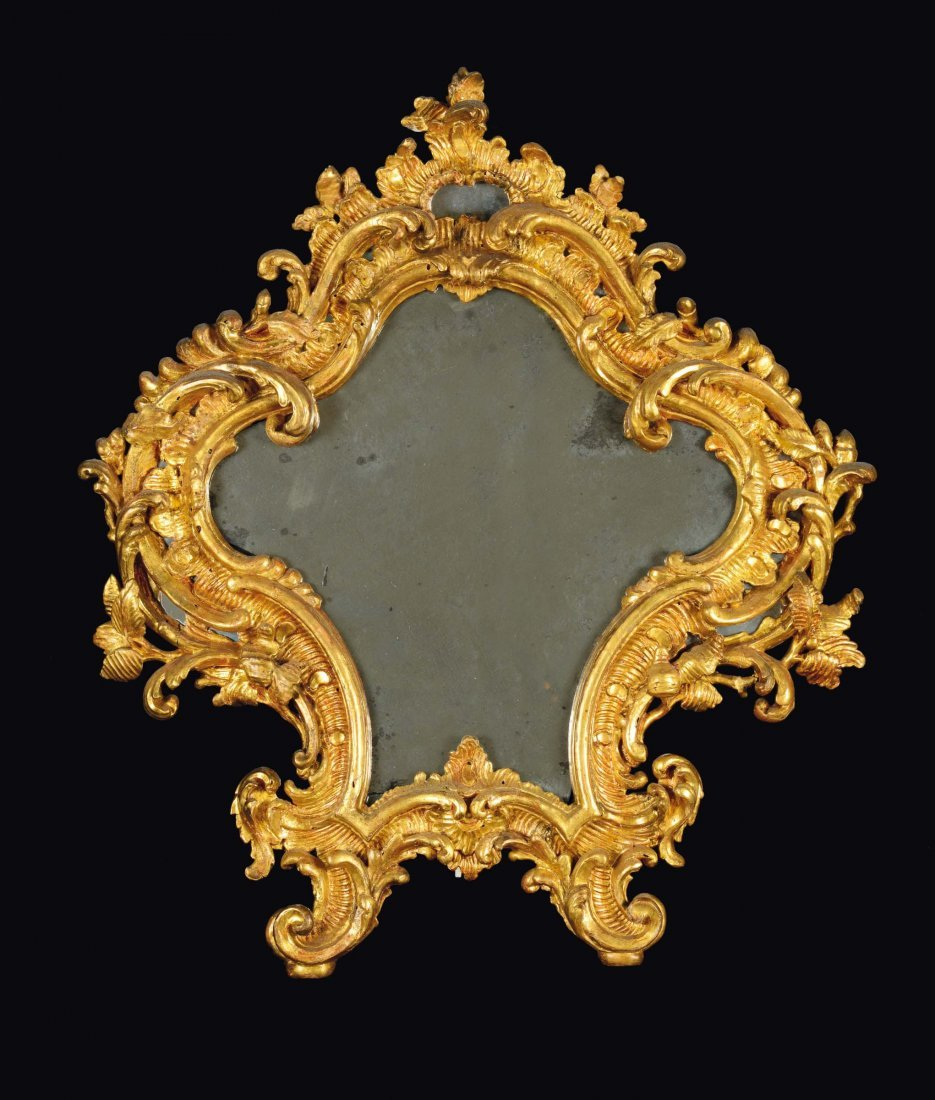 A mirror in the shape of a Louis XV table or