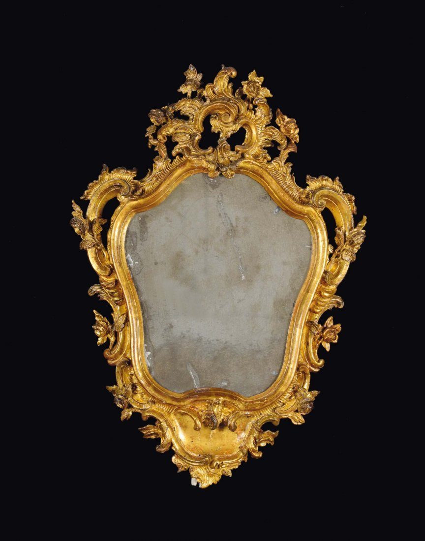 A small Louis XV mould carved and gilt wood mirror,