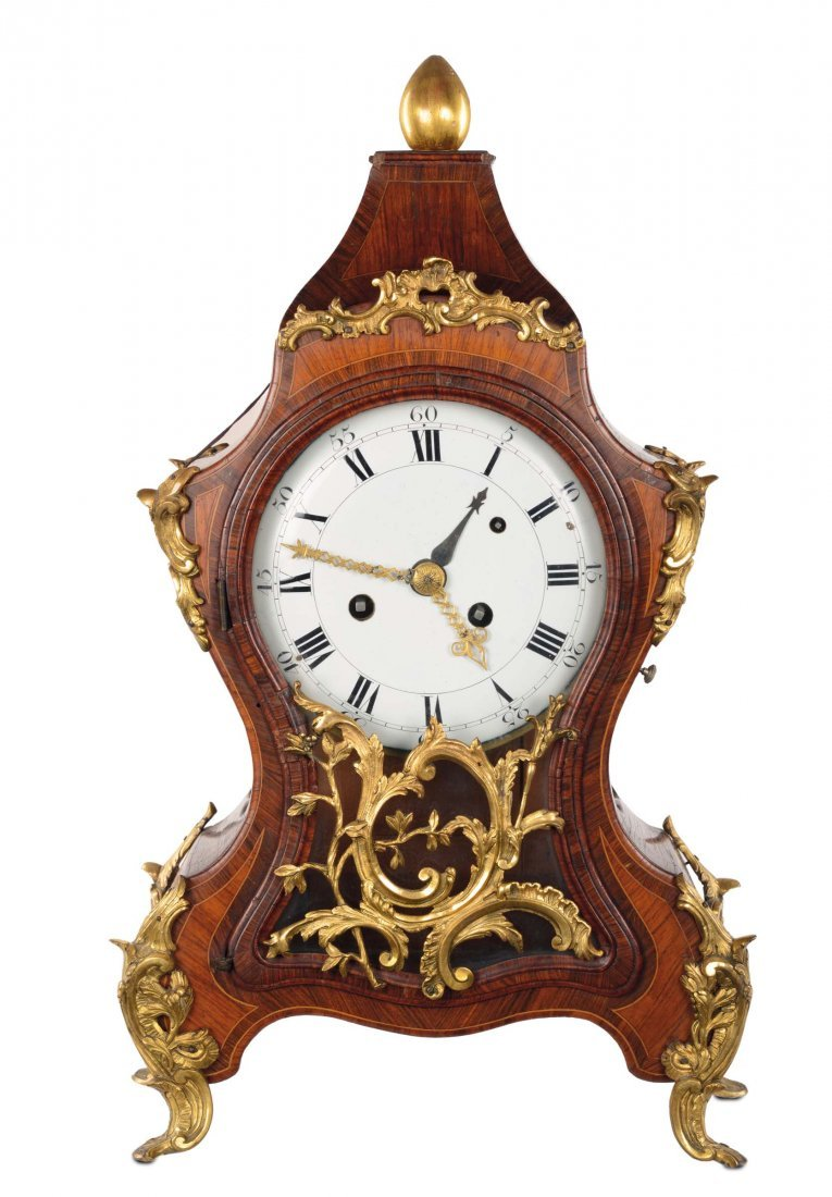 A Louis XV table-clock with mould rosewood and bois de