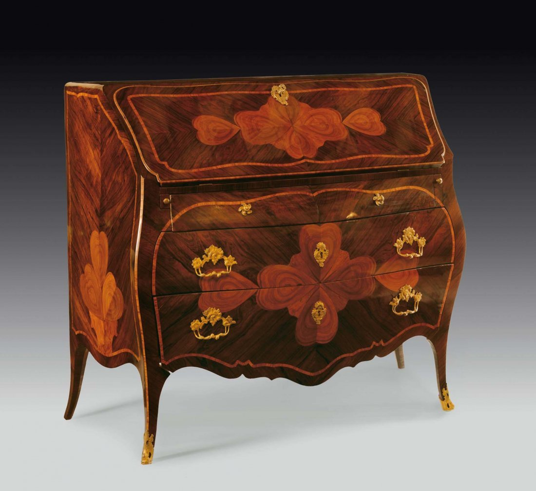 A Louis XV rosewood veneered with four-leaved clover