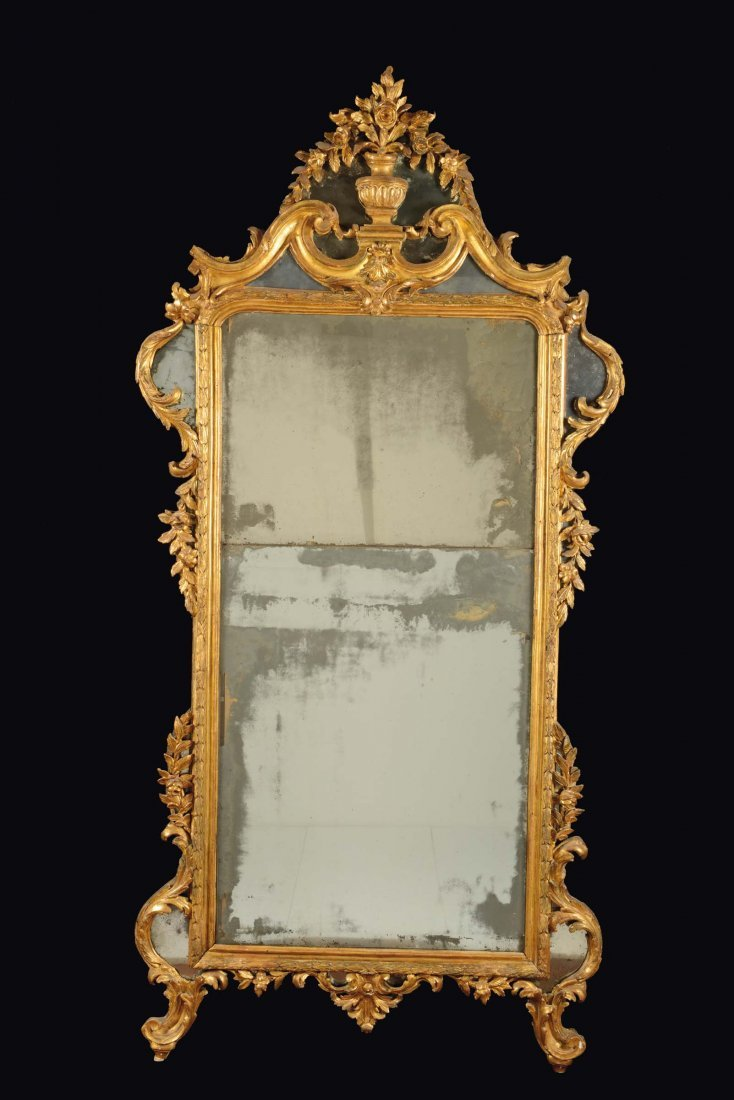 A carved and gilt wood mirror, Genoa, late 18th century