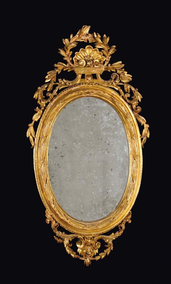 A small Louis XVI gilt wood oval mirror, Genoa, late