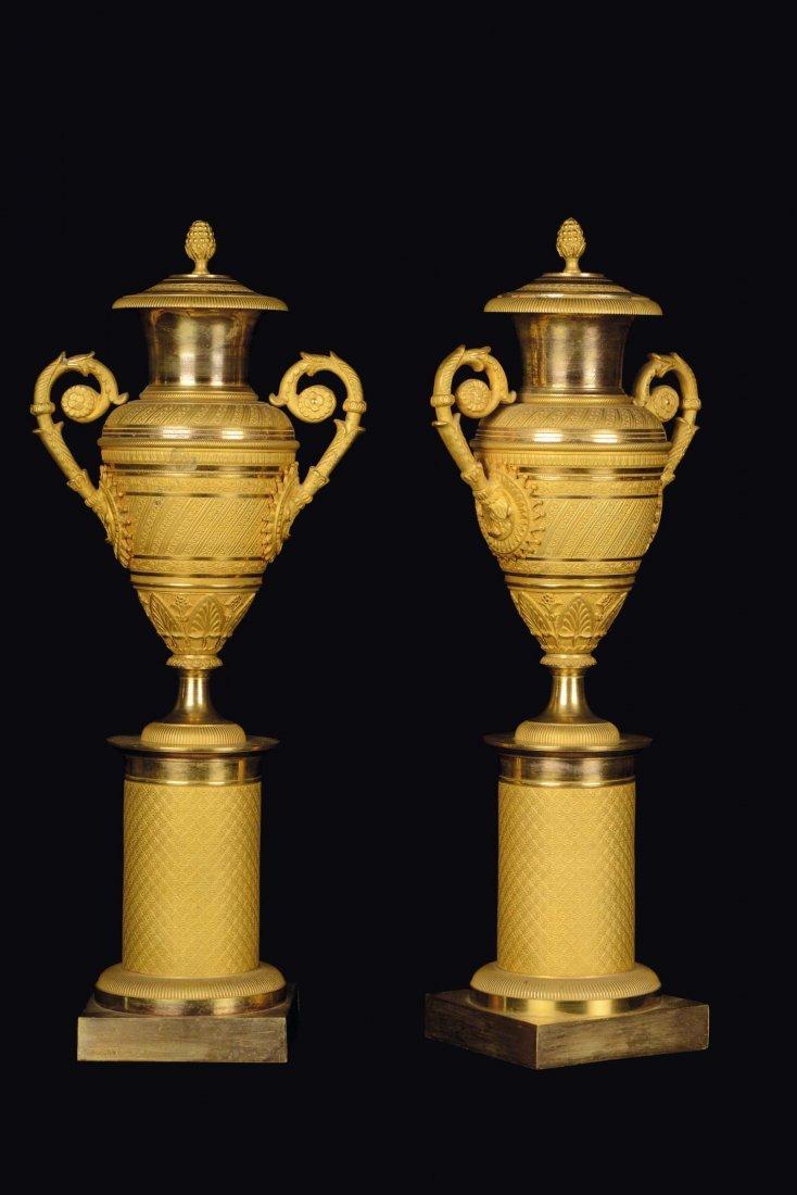 A pair of gilt bronze amphora cassolettes, Empire
