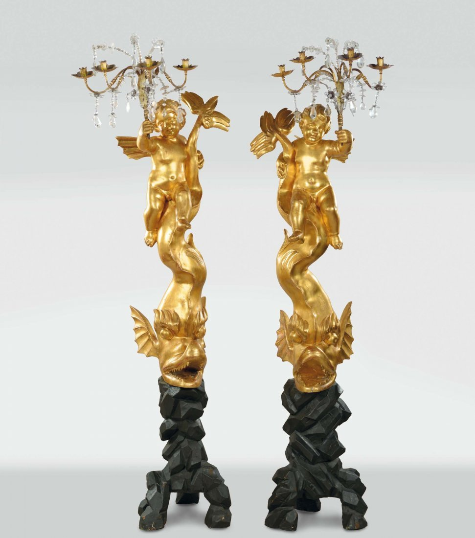 A pair of gilt wood torchères sculpted in the shape of