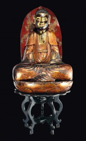 A Large Carved Gilt And Lacquered Wood Figure Of Buddha