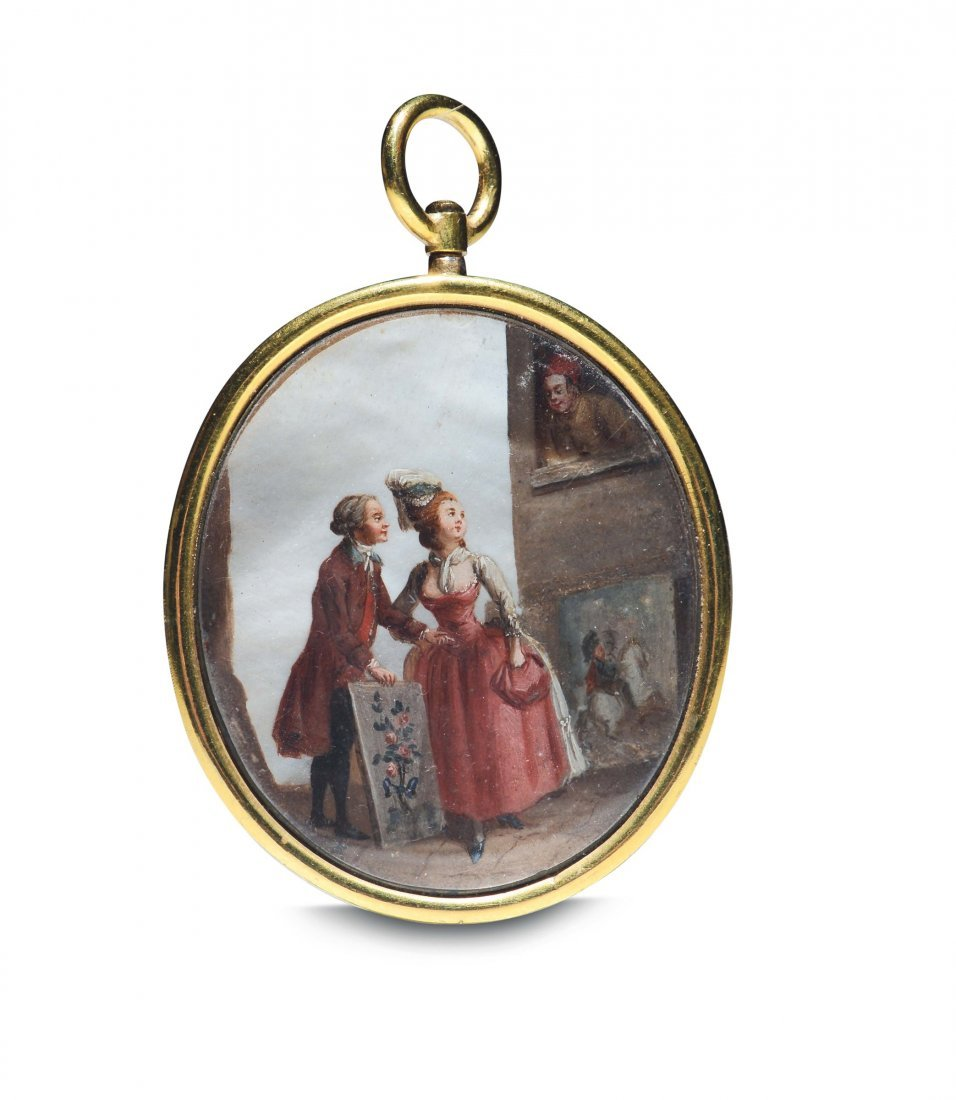 A golden oval pendant with a miniature on mother of