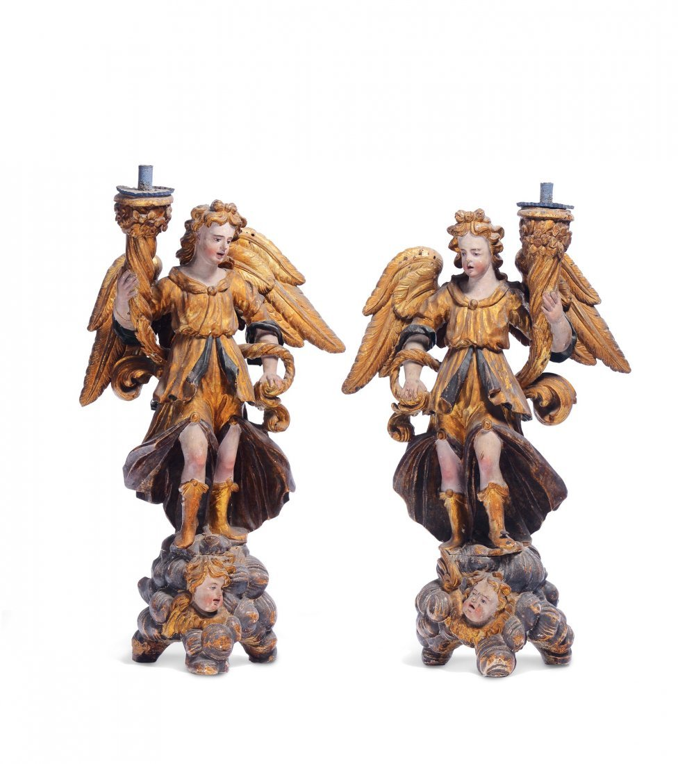 A pair of angel candle holders, Lombardy, mid 17th