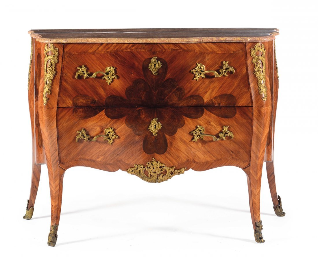 A rare and important Louis XV style chest of drawers