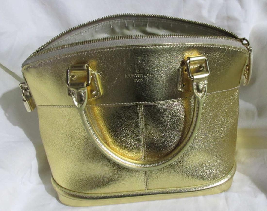 Louis Vuitton  Lockit Gold Leather Motif Bag