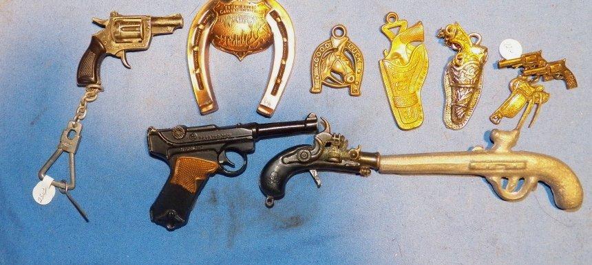 16: Assorted Pistol Gun Premiums