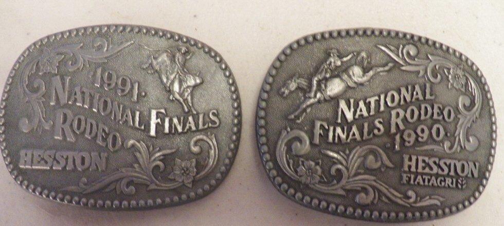 21: 2- NFR Belt Buckles 1990 &1991