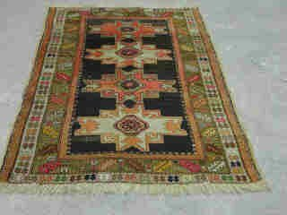 11: KAZAK RUG.  Approx. 5 t. 7 in. x 3 ft. 7