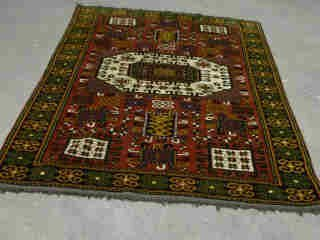 15: KAZAK RUG.  Approx. 6 ft. 11 in. x 5 ft.