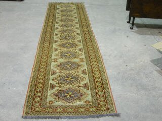 17: KAZAK RUNNER.  Approx. 12 ft. 8 in. x 2 f