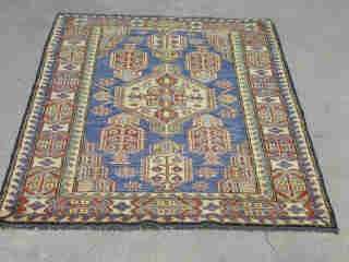 18: KAZAK RUG.  Approx. 5 ft. x 3 ft. 5 in.