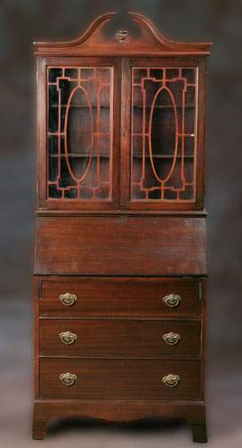 A CHIPPENDALE STYLE SECRETAIRE BOOKCASE IN