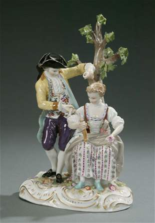 A CONTINENTAL PORCELAIN GROUP OF A COUPLE