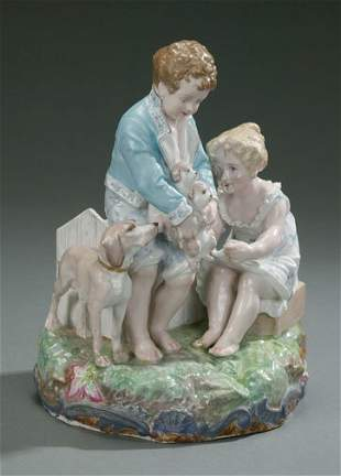 CONTINENTAL PORCELAIN GROUP OF A BOY AND