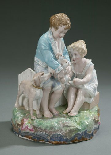 22: CONTINENTAL PORCELAIN GROUP OF A BOY AND
