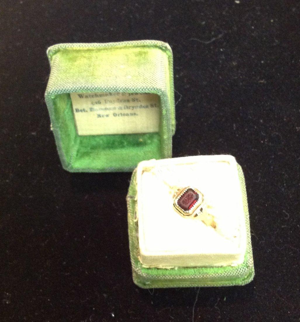 10k Garnet Ladies Ring; 1.5g