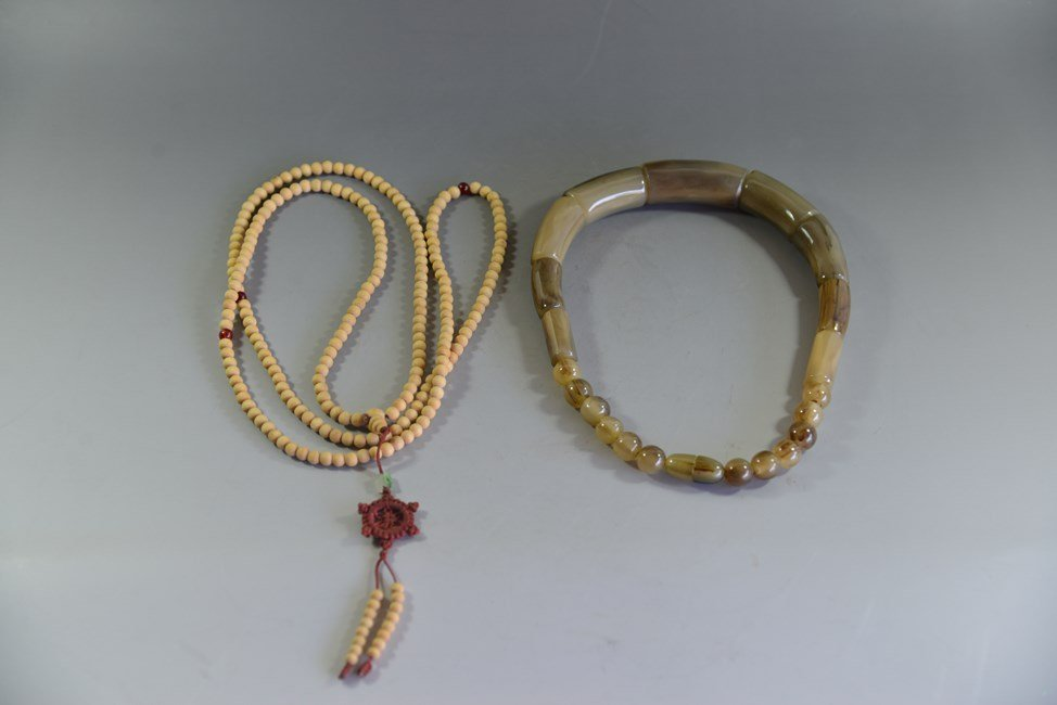 TWO CHINESE NECKLACES BEADS AND HORN