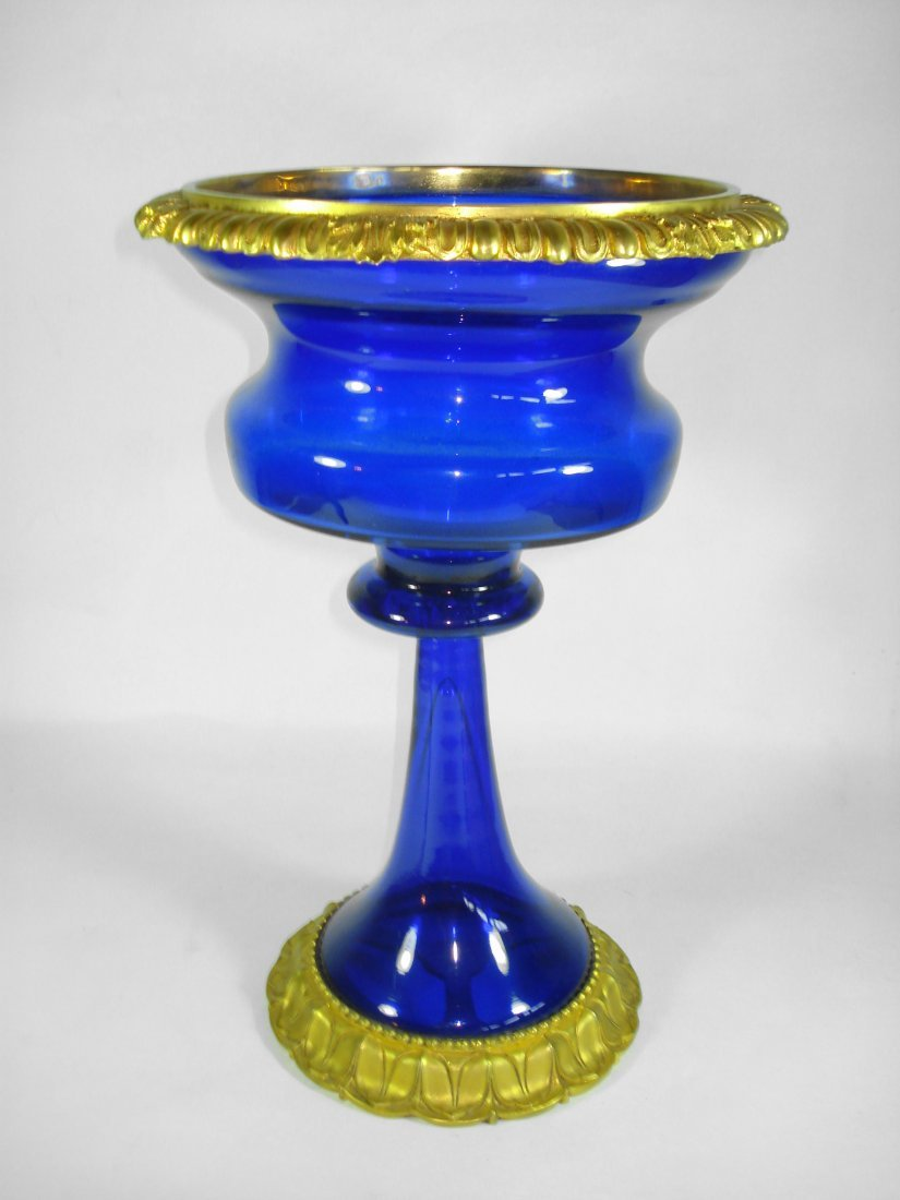 A BLUE AND GOLD TALL BODY CUP