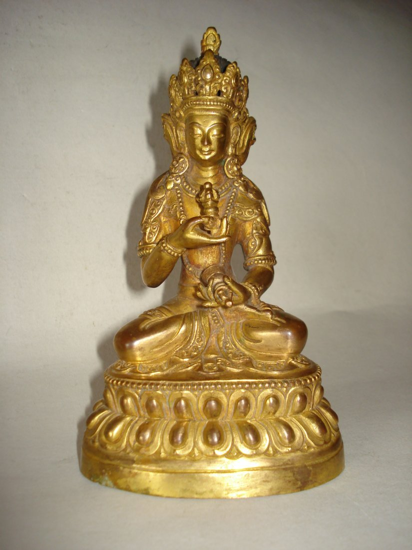 AN CHINESE TIBET GOLD COLORED BUDDHA ,