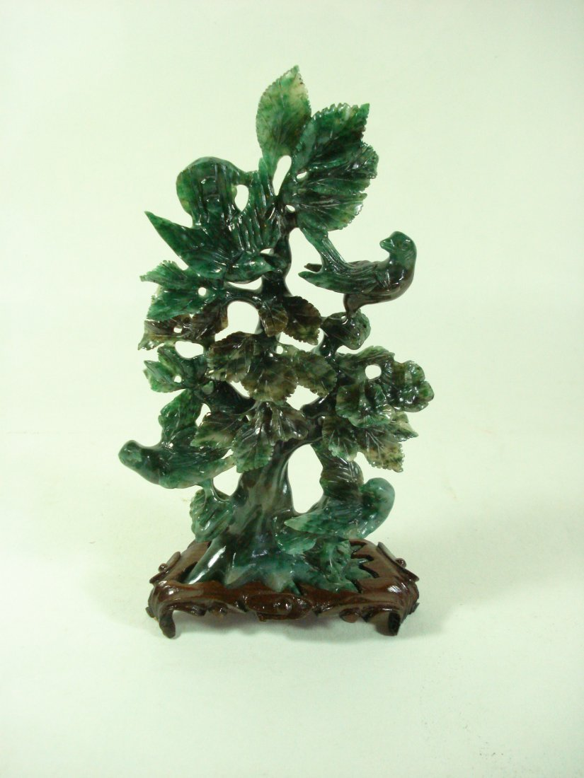 A CHINESE CARVING JADEITE