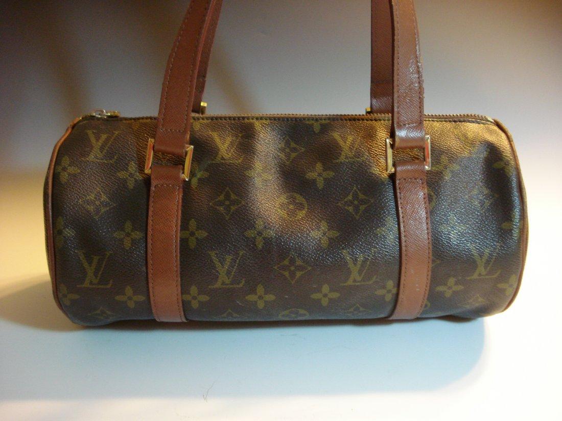 Designer: Louis Vuitton Artsy MM Handbag.
