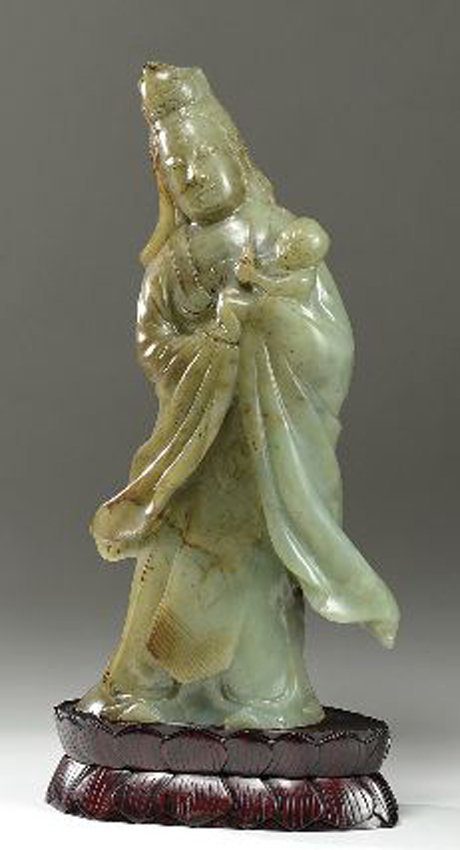 A CHINESE JADE GUANYIN WITH STAND.