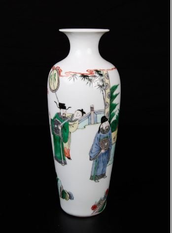A CHINESE PORCELAIN OFFICIALS FIGURE WHITE VASE