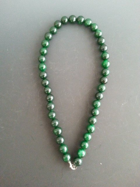 An Antique chinese carved Spinach jade necklace.
