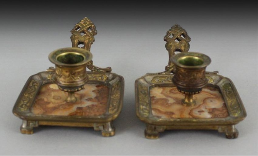 A PAIR OF CHINESE BRONZE & MARBLE CANDLESTICKS.